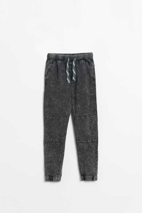 Knitted trousers with washed out effect